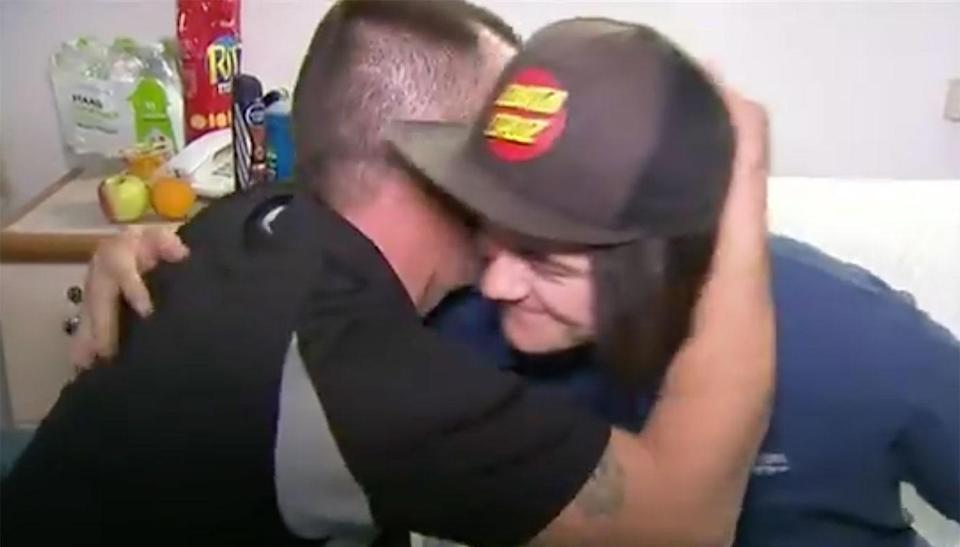 Liam's dad Adam embraces him in hospital.. Source: 7 News