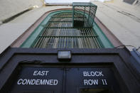 Shown is the entrance to the east block of death row at San Quentin State Prison Tuesday, Aug. 16, 2016, in San Quentin, Calif. The California Labor and Workforce Development Agency confirmed Tuesday, Dec. 1, 2020, that California has sent about $400 million in unemployment benefits to state prison inmates. In all records show 31,000 inmates have applied for benefits and about 20,800 were paid $400 million. A group of local and federal prosecutors said 133 inmates on death row were named in claims. (AP Photo/Eric Risberg, File)