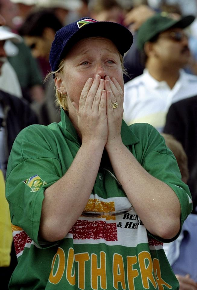17 Jun 1999:  A distraught South Africa fan after defeat by Australia in the World Cup semi-final at Edgbaston in Birmingham, England. The match finished a tie as Australia went through after finishing higher in the Super Six table. \ Mandatory Credit: Craig Prentis /Allsport