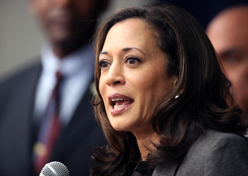 "FILE - This Nov. 16,2012 file photo shows California Attorney General Kamala Harris speaking during a news conference in Los Angeles. President Barack Obama praised Harris for more than her smarts and toughness at a Democratic Party event Thursday, April 4, 2013. The president also commended  Harris for being ""the best-looking attorney general"" during a Democratic fundraising lunch in the Silicon Valley.(AP Photo/Richard Vogel,File)"