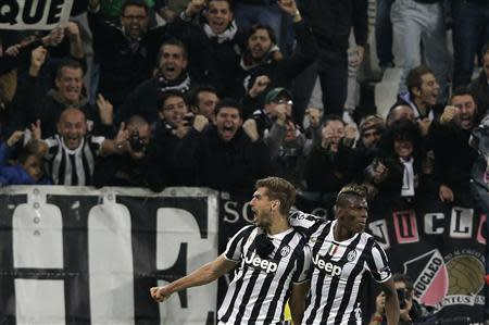 Juventus Llorente celebrates with his teammate Pogba after scoring against Real Madrid during their Champions League soccer match at Juventus stadium in Turin