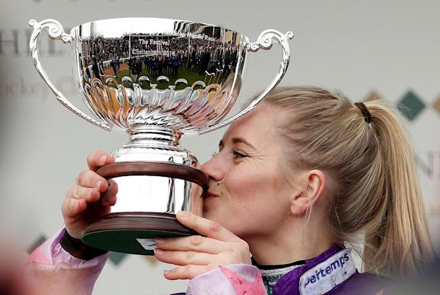 Horse Racing - Cheltenham Festival - Cheltenham Racecourse, Cheltenham, Britain - March 16, 2018 Bridget Andrews on Mohaayed celebrates with the trophy after winning the 14.10 Randox Health County Handicap Hurdle Action Images via Reuters/Andrew Boyers