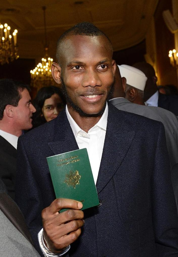 Lassana Bathily was granted French citizenship by the president himself, something he says had been a dream since his childhood in a small village on the Mali-Senegal border (AFP Photo/Eric Feferberg)