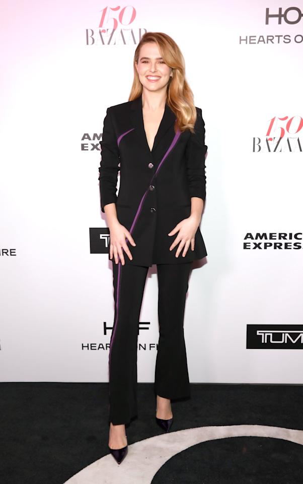 <p>For the <strong>Harper's BAZAAR</strong> celebration of the 150 Most Fashionable Women, Deutch donned a chic black Versace suit with purple accents and matching black heels.  </p>