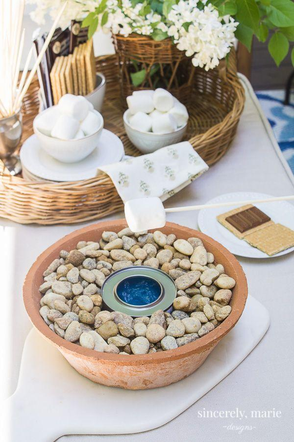 """<p>Made specifically for s'mores-loving families, this sweet little table top burner can be used when the weather is too warm for the fire pit.</p><p><strong>Get the tutorial at <a href=""""https://sincerelymariedesigns.com/diy-tabletop-marshmallow-roaster/"""" rel=""""nofollow noopener"""" target=""""_blank"""" data-ylk=""""slk:Sincerely, Marie Designs"""" class=""""link rapid-noclick-resp"""">Sincerely, Marie Designs</a>.</strong></p><p><a class=""""link rapid-noclick-resp"""" href=""""https://www.amazon.com/Royal-Imports-Decorative-Ornamental-Landscaping/dp/B0143IX8W6/?tag=syn-yahoo-20&ascsubtag=%5Bartid%7C10050.g.31966151%5Bsrc%7Cyahoo-us"""" rel=""""nofollow noopener"""" target=""""_blank"""" data-ylk=""""slk:SHOP RIVER ROCKS"""">SHOP RIVER ROCKS</a></p>"""