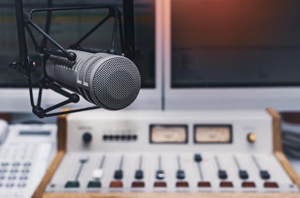 A radio mixing board and mic are pictured.