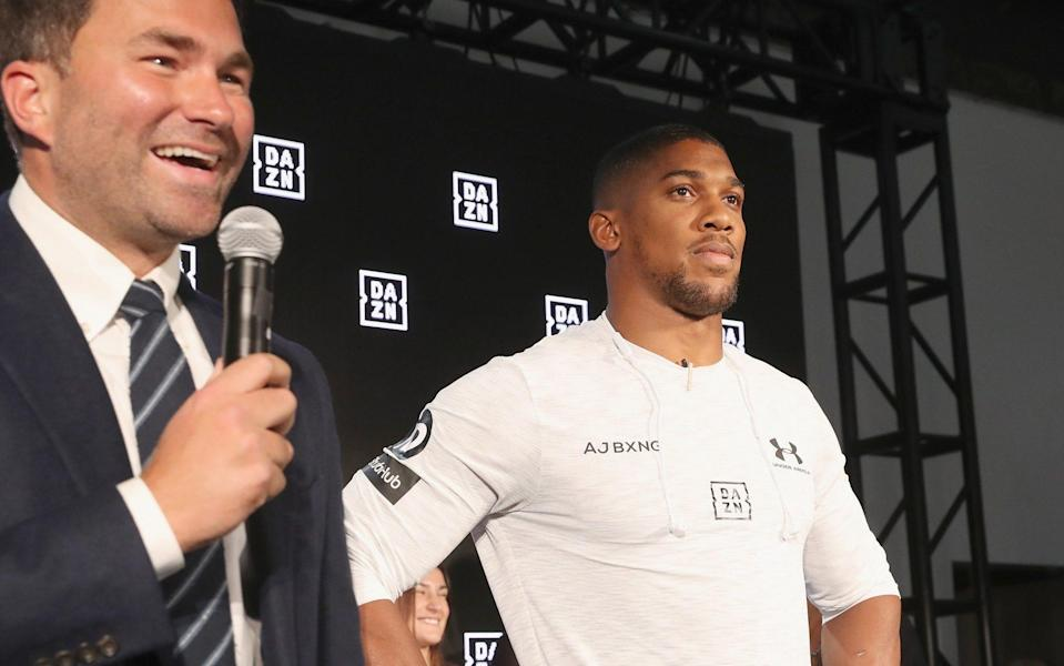 Eddie Hearn and Anthony Joshua on stage - GETTY IMAGES