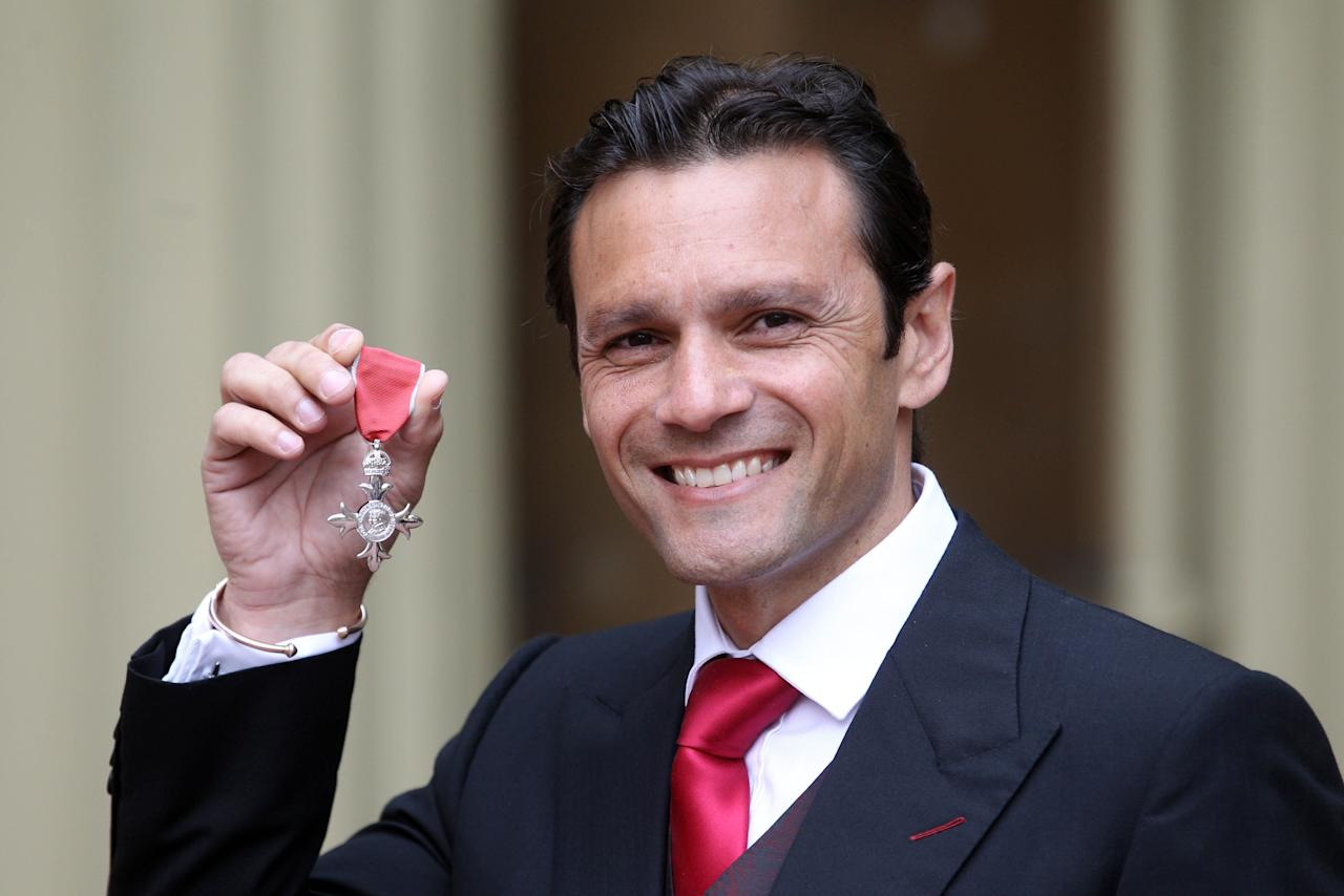 Cricketer Mark Ramprakash who was awarded an MBE at Buckingham Palace during the investiture ceremony.