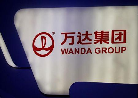 FILE PHOTO: A logo of Wanda Group is seen at a Wanda Group and China Union Pay joint news conference in Beijing, China, March 2, 2017. REUTERS/Thomas Peter/File Photo
