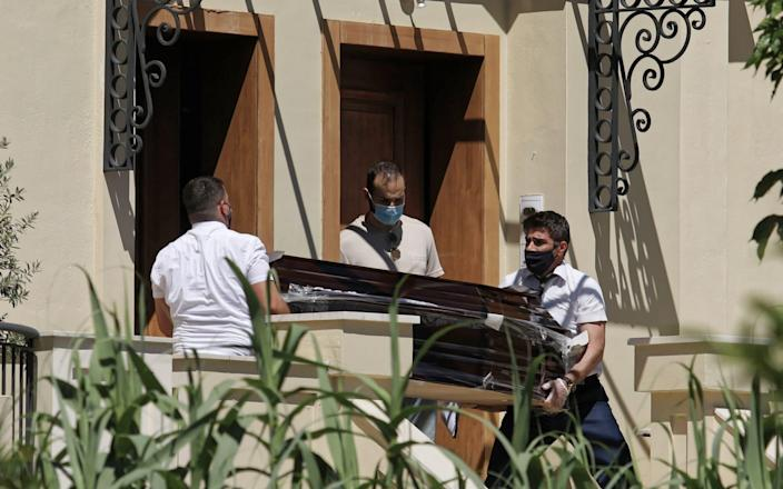 A coffin is taken out of the house where Caroline Crouch was murdered in Glyka Nera in the outskirts of Athens - John Liakos/Intime News/Athena Pictures /Athena Picture Agency Ltd