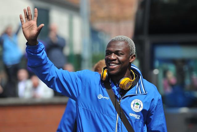 Wigan Athletic's Arouna Kone waves to the crowd as they depart from Wigan North Western Station, Wigan.