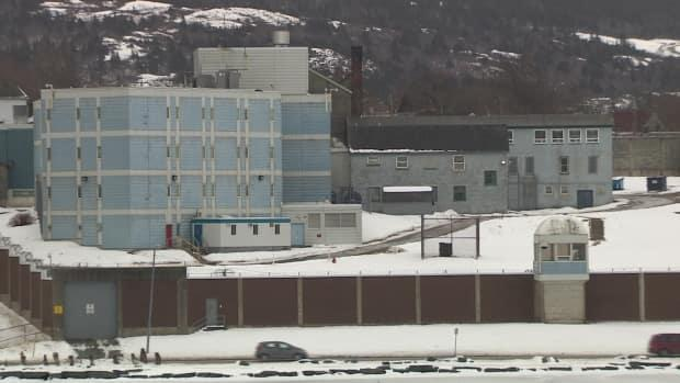 Ten guards at Her Majesty's Penitentiary have been charged in relation to the death of inmate Jonathan Henoche on Nov. 6, 2019. An arbitrator has now put the province on the hook for their legal fees. (CBC - image credit)