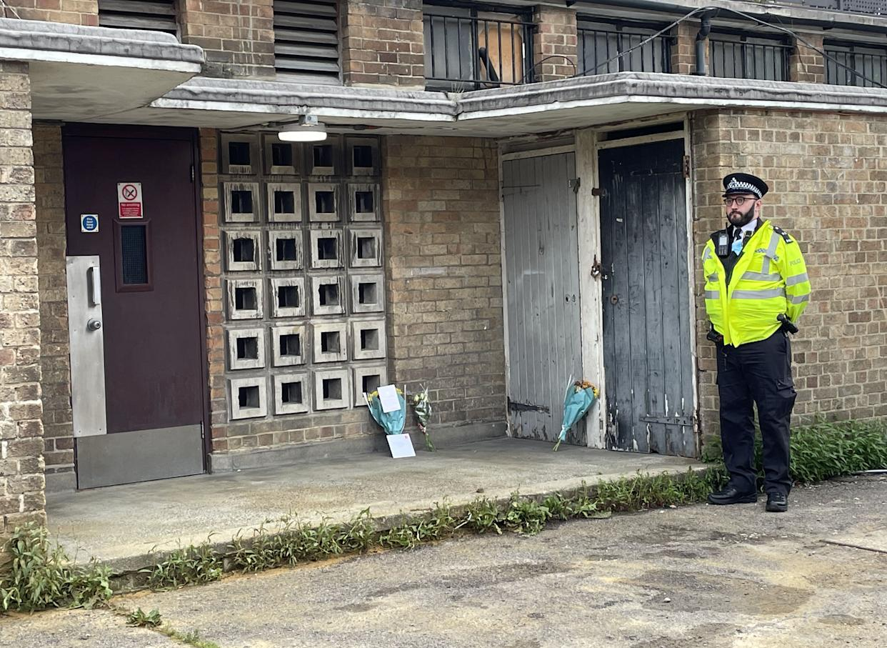 Police at the scene in Churchill Terrace, Chingford, east London, after 45-year-old James Markham was stabbed to death after confronting a group of youths..