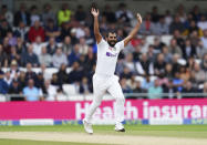 India's Mohammed Shami celebrates the dismissal of England's Craig Overton during the third day of third test cricket match between England and India, at Headingley cricket ground in Leeds, England, Friday, Aug. 27, 2021. (AP Photo/Jon Super)