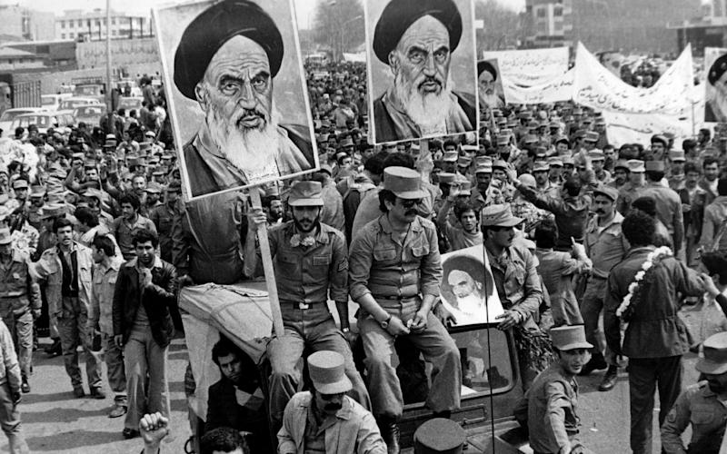 The Iranian Islamic Republic Army demonstrates in solidarity with people in the street during the Iranian revolution - Getty Images