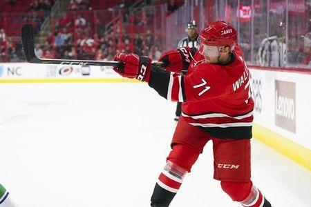 Oct 9, 2018; Raleigh, NC, USA; Carolina Hurricanes center Lucas Wallmark (71) takes a shot against the Vancouver Canucks at PNC Arena. The Carolina Hurricanes defeated the Vancouver Canucks 5-3. Mandatory Credit: James Guillory-USA TODAY Sports