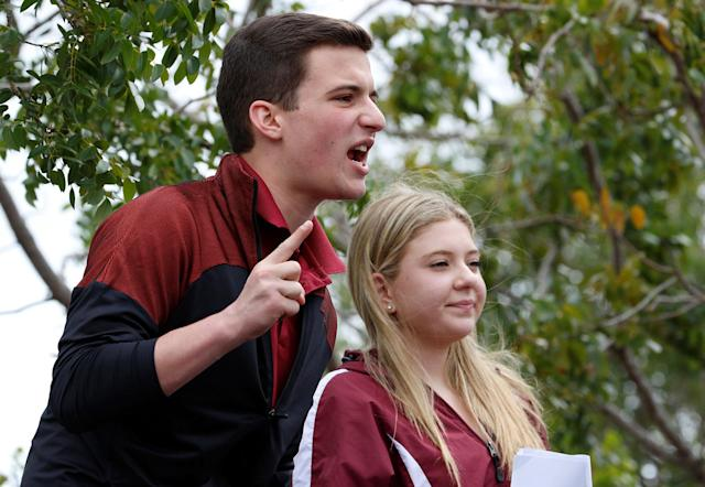 <p>Marjory Stoneman Douglas High School student leaders Cameron Kasky and Jaclyn Corin speak to the crowd prior to boarding buses travelling to Tallahassee, Florida to meet with legislators, in Coral Springs, Fla., Feb. 20, 2018. (Photo: Joe Skipper/Reuters) </p>