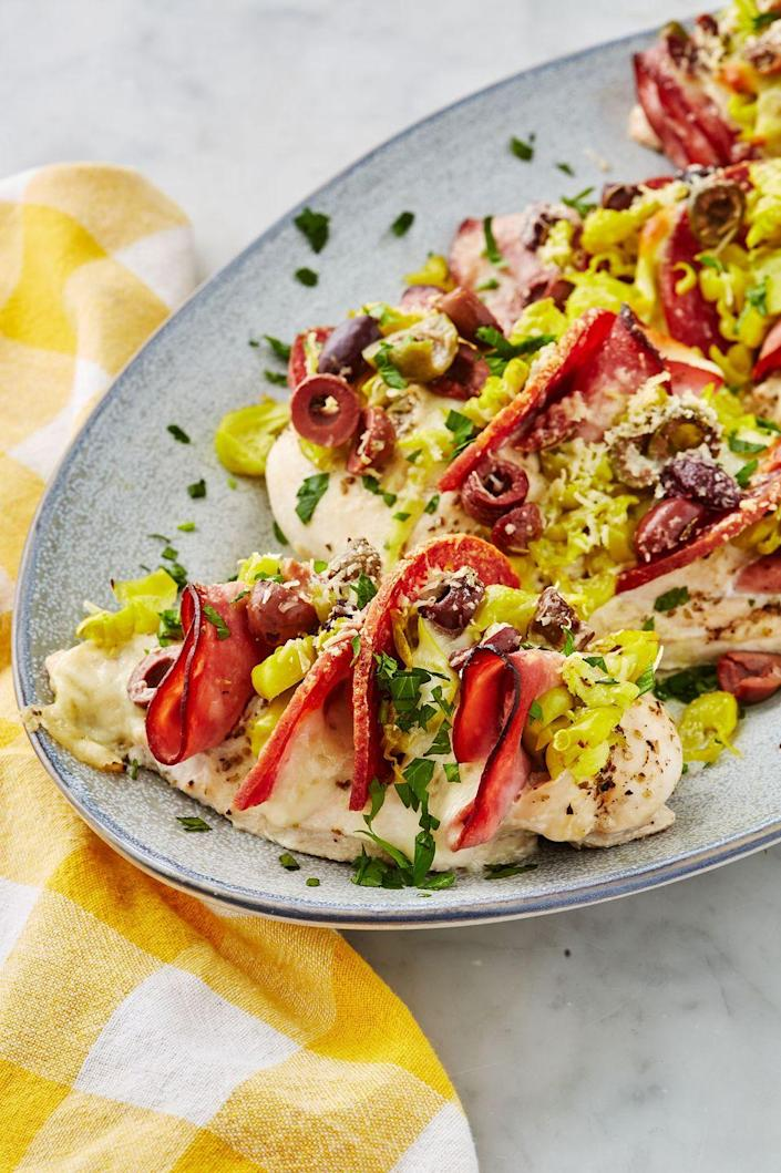"""<p>This super simple chicken dinner boasts an absolute knockout of flavor.</p><p>Get the recipe from <a href=""""https://www.delish.com/cooking/recipe-ideas/a22987290/antipasto-stuffed-chicken-recipe/"""" rel=""""nofollow noopener"""" target=""""_blank"""" data-ylk=""""slk:Delish."""" class=""""link rapid-noclick-resp"""">Delish.</a></p>"""