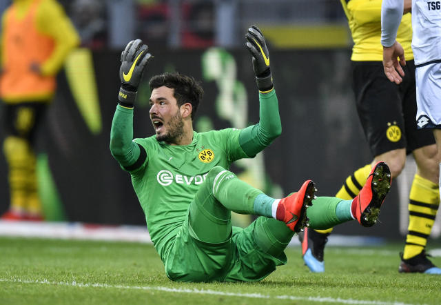 Dortmund goalkeeper Roman Buerki reacts during the German Bundesliga soccer match between Borussia Dortmund and TSG 1899 Hoffenheim in Dortmund, Germany, Saturday, Feb. 9, 2019. (AP Photo/Martin Meissner)