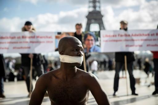 Senegalese artist Alioune Diagne perfoms in Paris  during a gathering in support French-Iranian academic Fariba Abdelkhah and French academic Roland Marchal, detained in Iran