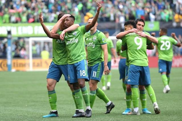 Seattle's Kelvin Leerdam, with arms raised, celebrates with teammates after putting the Sounders ahead on their way to a 3-1 victory over Toronto FC in the MLS Cup final on Sunday (AFP Photo/Abbie Parr)