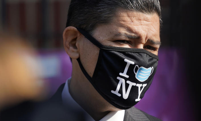 New York City Schools Chancellor Richard Carranza wears a mask during a news conference at the Mosaic Pre-K Center on the first day of school, Monday, Sept. 21, 2020, in New York. The city public schools delayed reopening for two weeks. (AP Photo/Mark Lennihan)
