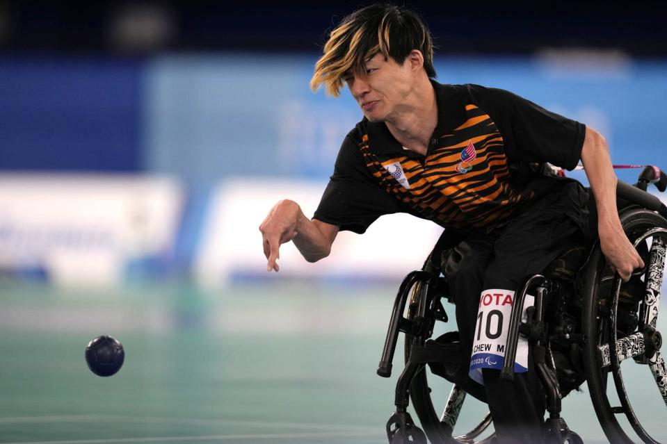 """<span class=""""caption"""">Malaysia's Chew Wei Lun plays a shot during a gold medal Boccia match at the Tokyo Paralympic Games. Boccia is only one of three summer Paralympic sports that powerchair users can compete in.</span> <span class=""""attribution""""><span class=""""source"""">(AP Photo/Shuji Kajiyama)</span></span>"""