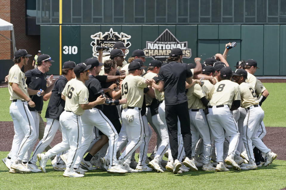 Vanderbilt players celebrate after beating East Carolina in an NCAA college baseball super regional game Saturday, June 12, 2021, in Nashville, Tenn. Vanderbilt won 4-1 to sweep the three-game series and advance to the College World Series. (AP Photo/Mark Humphrey)