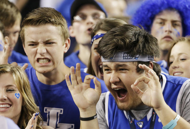 Kentucky fans cheer before their game against Wisconsin at their NCAA Final Four tournament college basketball semifinal game Saturday, April 5, 2014, in Arlington, Texas. (AP Photo/David J. Phillip)