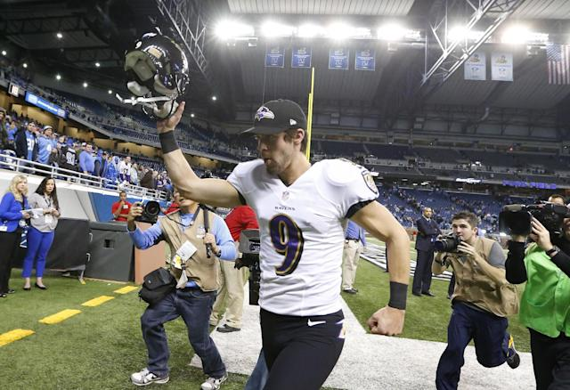 Baltimore Ravens kicker Justin Tucker (9) runs off the field after the Ravens defeated the Detroit Lions 18-16 in an NFL football game in Detroit, Monday, Dec. 16, 2013. (AP Photo/Paul Sancya)