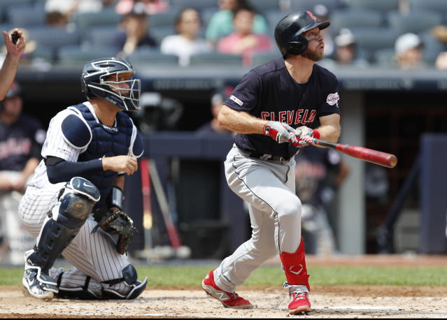 Cleveland Indians' Mike Freeman and New York Yankees' catcher Gary Sanchez, left, watch Freeman's three-run, home run during the second inning of a baseball game, Sunday, Aug. 18, 2019, in New York. (AP Photo/Kathy Willens)