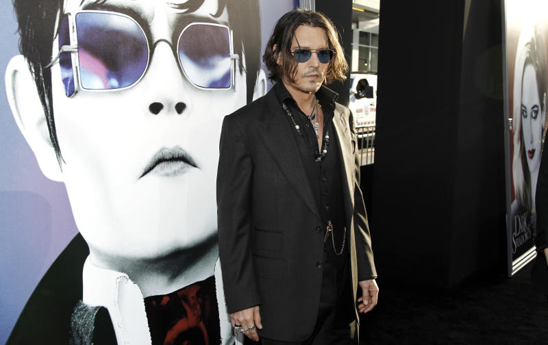 """Cast member Johnny Depp arrives at the premiere of """"Dark Shadows"""" in Los Angeles, Monday, May 7, 2012. """"Dark Shadows"""" opens in theaters May 11, 2012. (AP Photo/Matt Sayles)"""