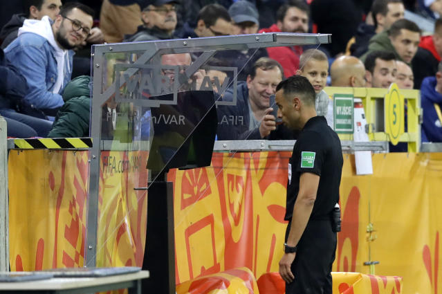 Referee Abdelkader Zitouni watching the VAR monitor during the Group D U20 World Cup soccer match between USA and Qatar, in Tychy, Poland, Thursday, May 30, 2019. (AP Photo/Sergei Grits)