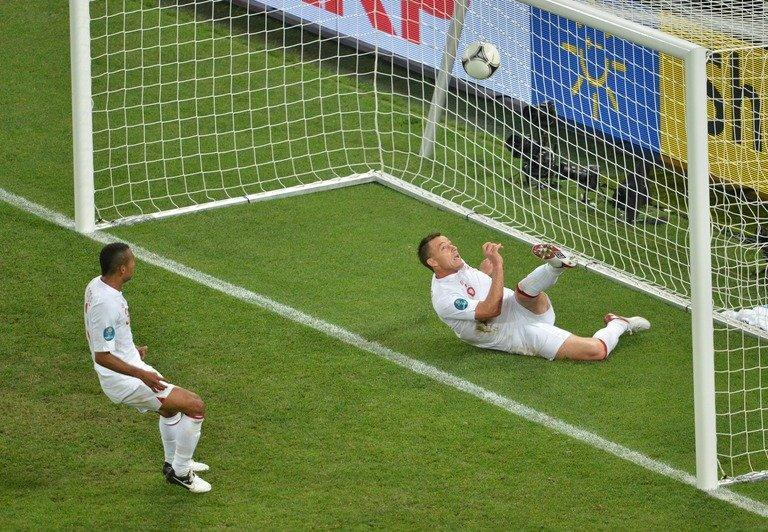 England defender John Terry (R) clears the ball from behind the goal line during the Euro 2012 clash with Ukraine on June 19, 2012. Television replays showed that the ball had crossed the line, igniting the debate about using technology to help referees
