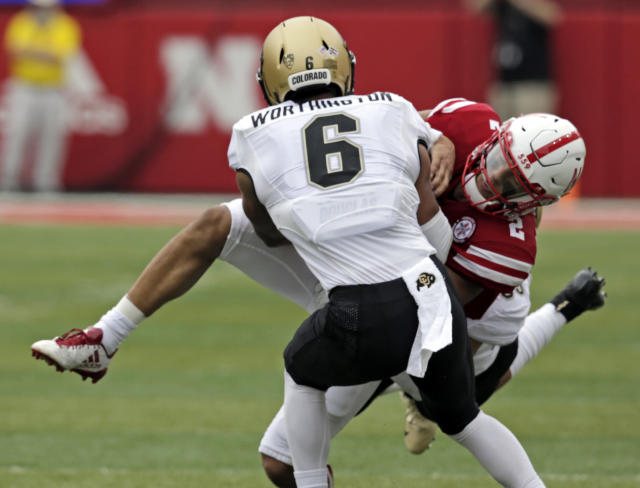 Nebraska quarterback Adrian Martinez (2) is tackled by Colorado defensive back Evan Worthington (6) during the first half of an NCAA college football game in Lincoln, Neb., Saturday, Sept. 8, 2018. (AP Photo/Nati Harnik)