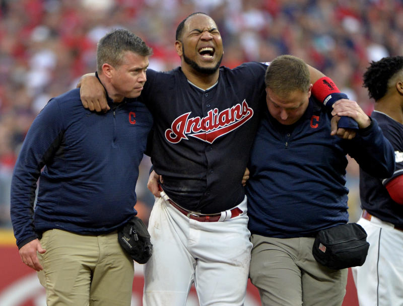 Indians' star Edwin Encarnacion is carried off the field after rolling his ankle at second base in the first inning of Game 2 of the ALDS. (AP)