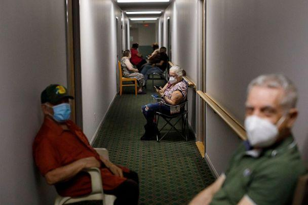 PHOTO: Seniors sit in the hallway after receiving their second dose of the Pfizer COVID-19 vaccine by healthcare workers from Humber River Hospital, inside Caboto Terrace, an independent seniors residence, on April 1, 2021, in Toronto, Canada. (Cole Burston/Getty Images)