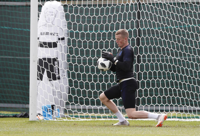 England goalkeeper Jordan Pickford collects the ball as he takes part in a training session for the England team at the 2018 soccer World Cup, in the Spartak Zelenogorsk ground, Zelenogorsk near St. Petersburg, Russia, Thursday, June 21, 2018. (AP Photo/Alastair Grant)