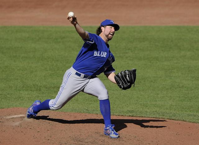 Toronto Blue Jays starterR.A. Dickey delivers a pitch against the Baltimore Orioles during the third inning of a baseball game, Saturday, June 14, 2014, in Baltimore. (AP Photo/Nick Wass)