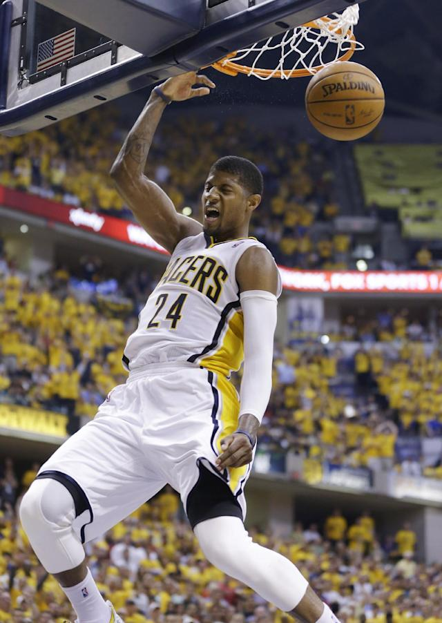 Indiana Pacers forward Paul George dunks against the Miami Heat during the second half of Game 5 of the NBA basketball Eastern Conference finals in Indianapolis, Wednesday, May 28, 2014. (AP Photo/Michael Conroy)