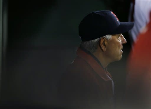 Boston Red Sox manager Bobby Valentine watches from the dugout during the sixth inning of a baseball game against the Tampa Bay Rays at Fenway Park in Boston, Wednesday, Sept. 26, 2012. (AP Photo/Elise Amendola)