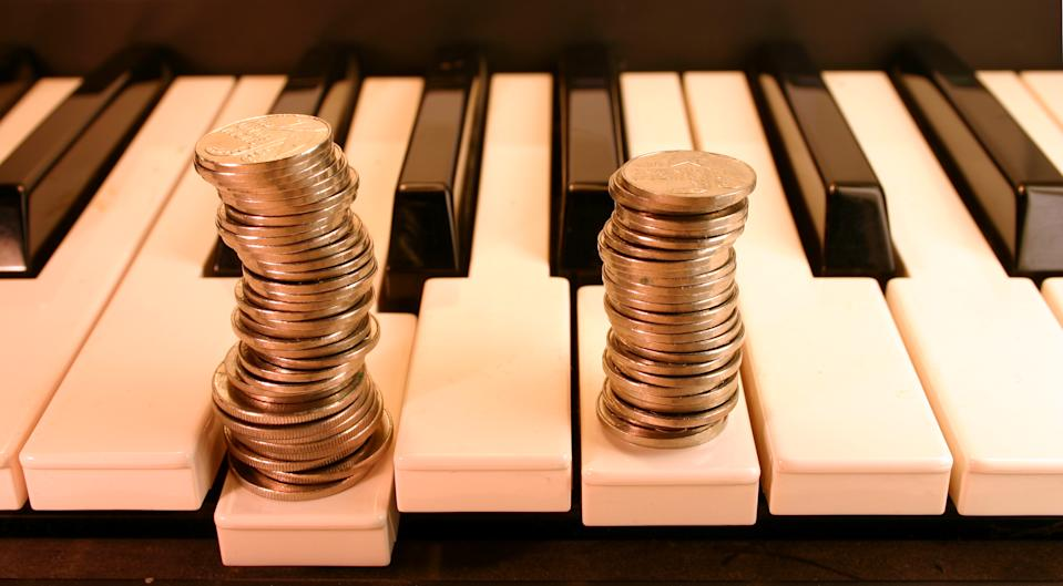 Piano keyboard and Coins. (earn from music)