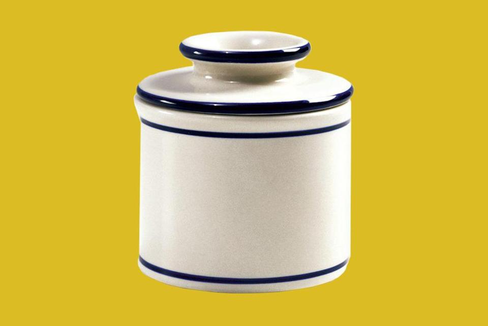 """<p>A simple glazed stoneware crock that holds up to a stick of butter never goes out of style. This one must be washed by hand, but it's worth the effort.</p> <p><em><strong>Shop Now: </strong>Norpro White Butter Crock Keeper $8.26, <a href=""""http://goto.walmart.com/c/249354/565706/9383?subId1=MSLWhyEveryHomeCookShouldOwnaButterCrockPlusOurFavoriteOptionsontheMarketRightNowvspence2FooGal7844477202007I&u=https%3A%2F%2Fwww.walmart.com%2Fip%2FNorpro-White-Porcelain-Butter-Crock-Keeper%2F38479731"""" rel=""""nofollow noopener"""" target=""""_blank"""" data-ylk=""""slk:walmart.com"""" class=""""link rapid-noclick-resp"""">walmart.com</a>.</em></p>"""