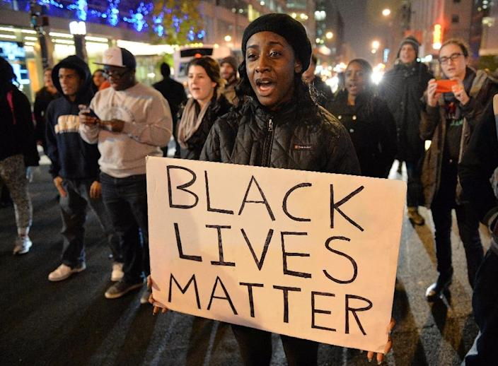 Protesters march in Washington, DC on December 5, 2014 during nationwide protests, after a grand jury decided not to charge a white police officer in the choking death of Eric Garner, a black man (AFP Photo/Mladen Antonov)
