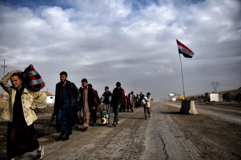 Displaced residents of western Mosul evacuate the area on March 14, 2017