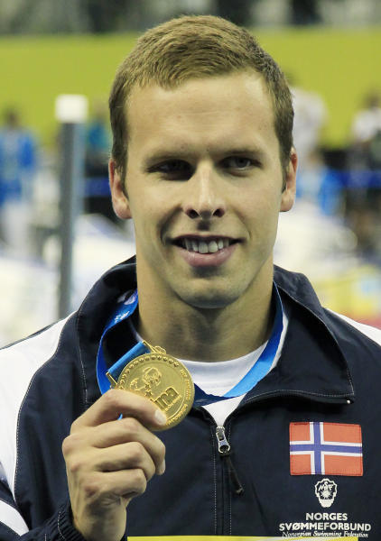FILE - In this Monday, July 25, 2011 file photo Norway's Alexander Dale Oen shows the gold medal he won in the men's 100m Breaststroke event at the FINA Swimming World Championships in Shanghai, China. The Norwegian Swimming Federation said Tuesday May 1, 2012, world champion Alexander Dale Oen has died after suffering a cardiac arrest. (AP Photo/Eugene Hoshiko, file)