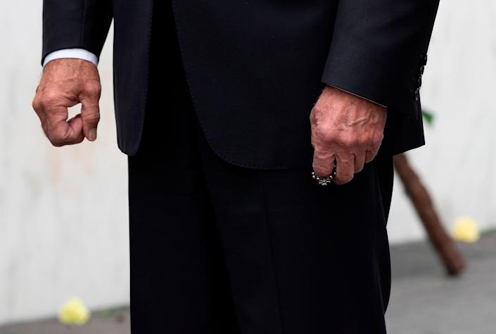 """Biden clutches a rosary after laying a wreath on Sept. 11, 2020, at the Flight 93 National Memorial, near Shanksville, Pa.<span class=""""copyright"""">Jim Watson—AFP/Getty Images</span>"""