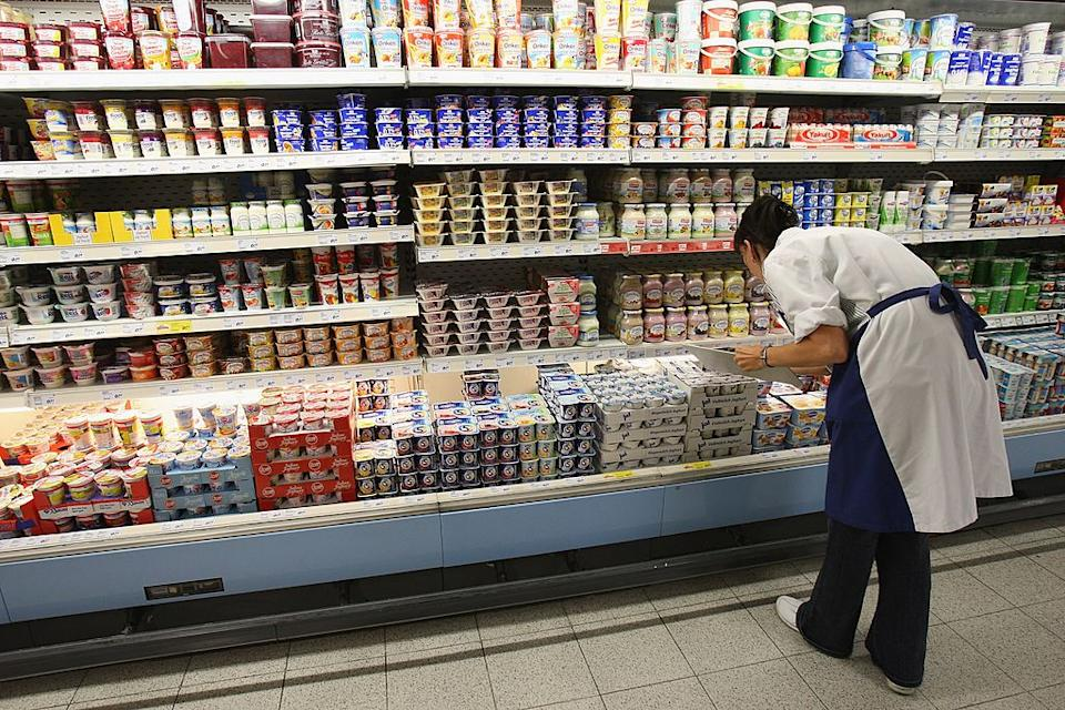 BERLIN - JULY 30:  A worker checks inventory of yogurt containers on a supermarket shelf July 30, 2007 in Berlin, Germany. German milk producers have announced they will raise prices on milk and dairy products starting July 31 nationwide by as much as 50%.  (Photo by Sean Gallup/Getty Images)