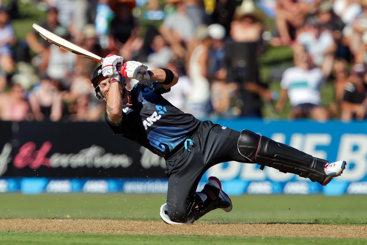 NAPIER, NEW ZEALAND - FEBRUARY 20:  Brendon McCullum of New Zealand looses his footing while batting during the second match of the international Twenty20 series between New Zealand and England at McLean Park on February 20, 2013 in Napier, New Zealand.  (Photo by Hagen Hopkins/Getty Images)