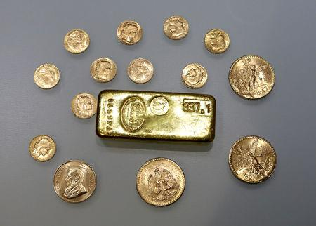 FILE PHOTO: A gold ingot and gold coins are seen in this illustration picture